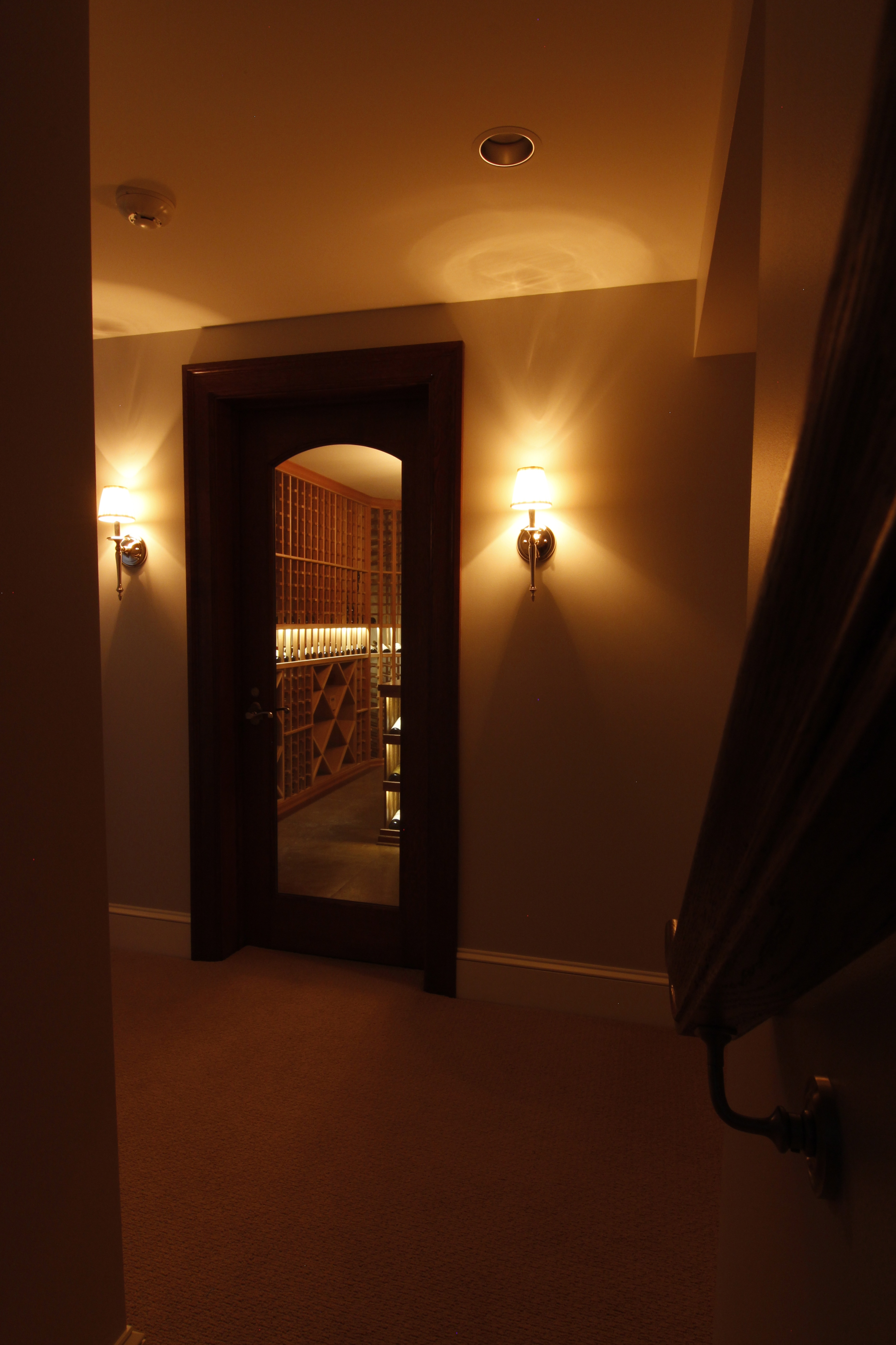 The preferred supplier of custom wine cellars saunas inviniti coming down the staircase to the basement arubaitofo Choice Image