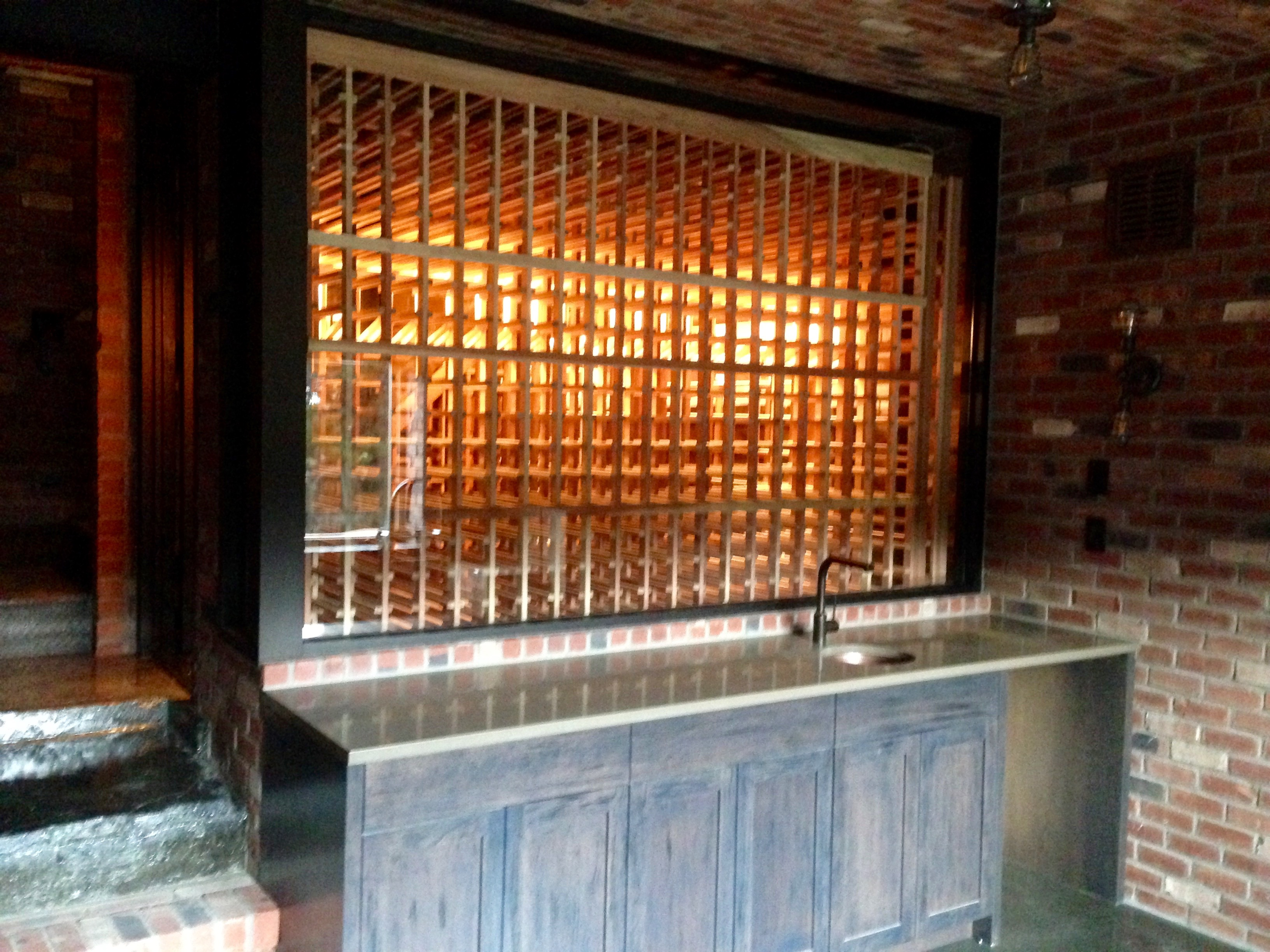 double deep racking backing up to glass enclosure bellevue custom wine cellar